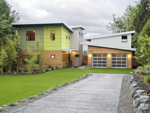 Fassadengestaltung-Einfamilienhaus-vorgarten-gestalten-mit einfahrt-garage-fassaden-farbe-grün