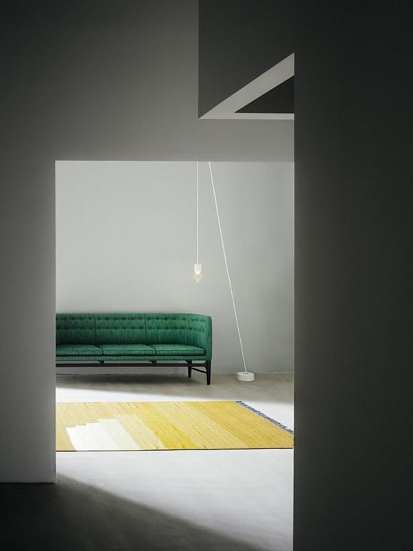 Grüne Sofas kunstvoll wand minimalistisch