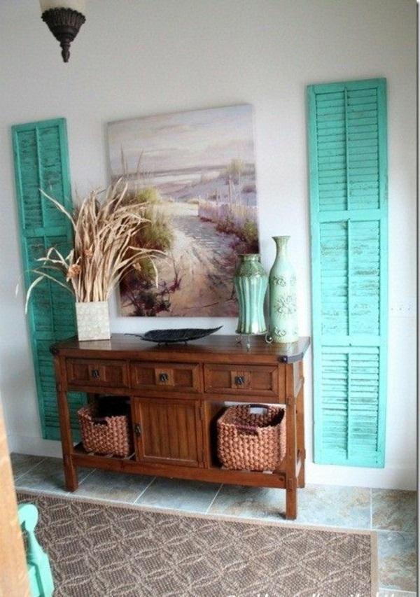 wohnzimmer essecke schiefergraue polstersofas weiße küchenzeile schwarze stühle