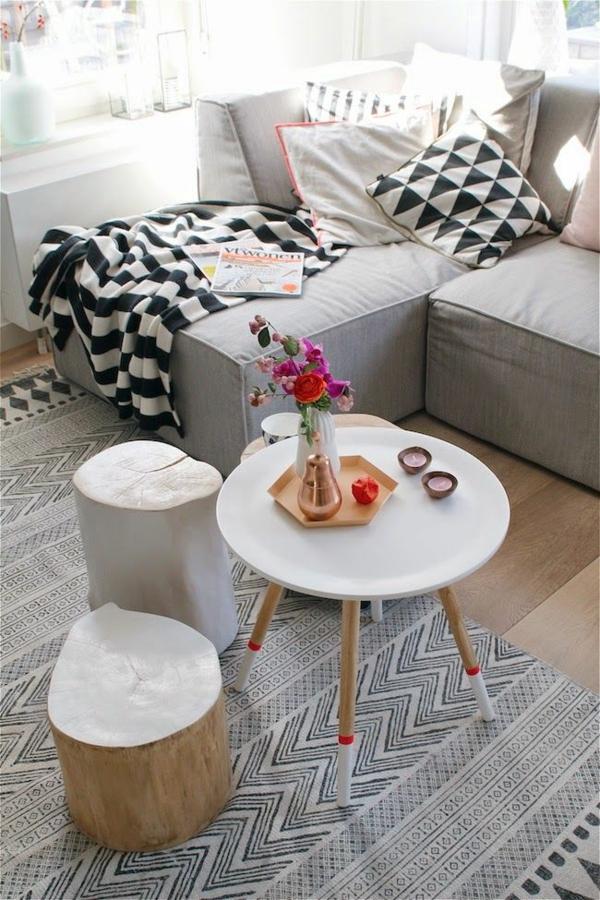 einrichtung wohnzimmer scandinavische möbel couchtisch rund teppichmuster sofa
