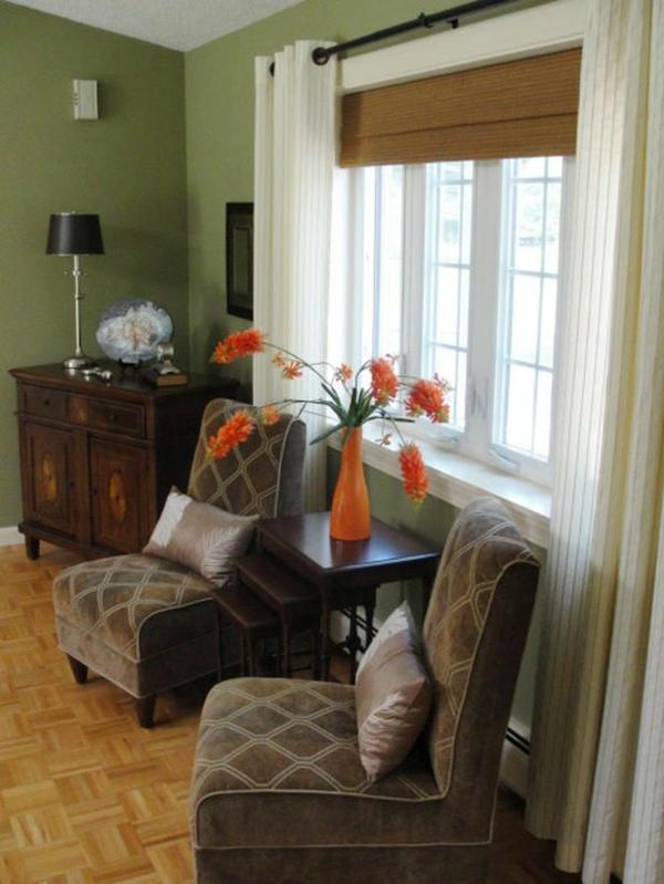 grüne wandfarbe und orange vase