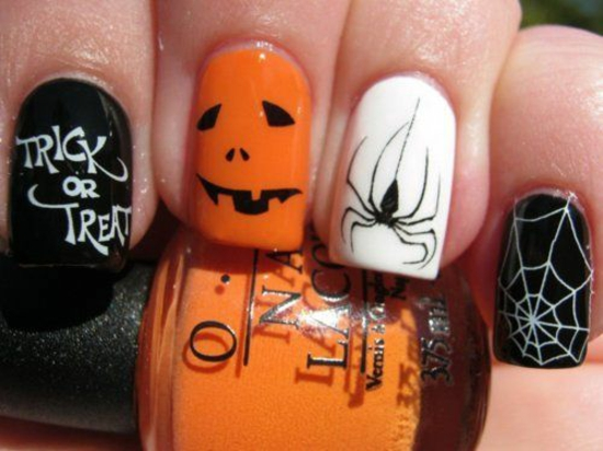 nagellack halloween ideen orange schwarz spinne kürbis gesicht süßes oder saures