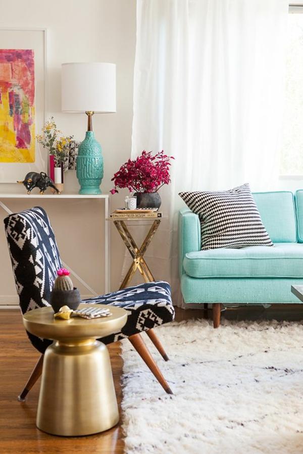 runder couchtisch gold wohnzimmer einrichtungsideen teppich holzboden