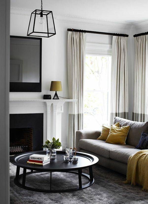 runder couchtisch wohnzimmer sofa kamin teppich