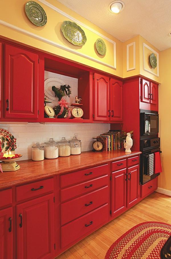 wandfarbe gelb rote küchenmöbel