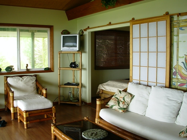 wohnzimmer mit grün wandfarbe