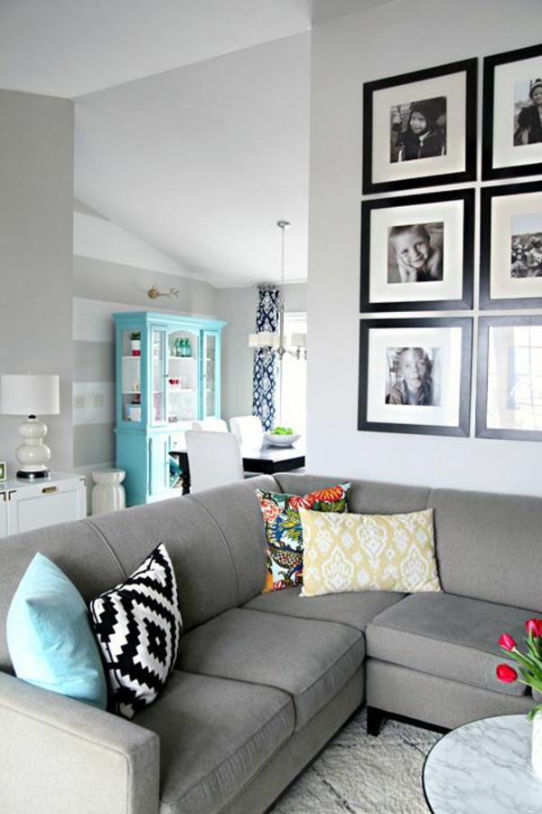 wohnzimmer wandgestaltung mit bildern farbideen türkisblau offener wohnraum