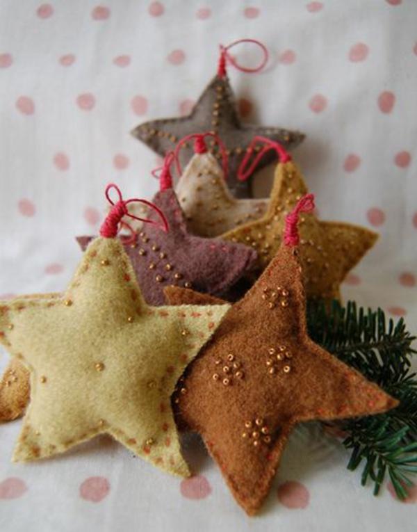 Weihnachtssterne filz stoff selber bastelnnähen braun gelb