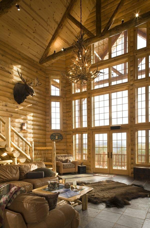holzbalken wohnzimmer rustikal wohnzimmermöbel fellteppich