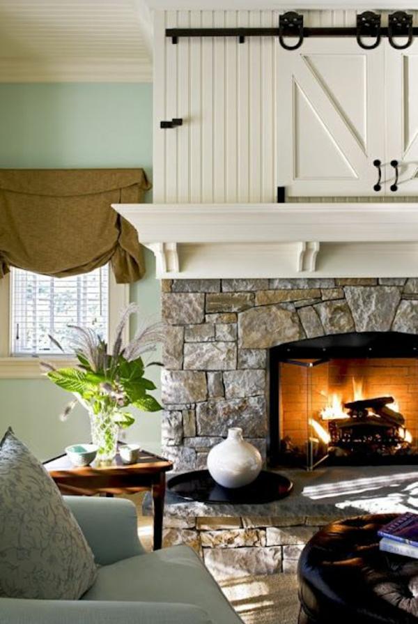 kamin steinwand wohnzimmer rustikal einrichten holzschränke