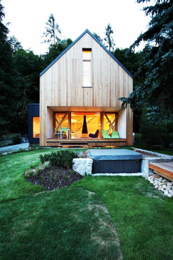 moderne architektur landhaus holzhäuser mit vorbau veranda bauen terrassengestaltung
