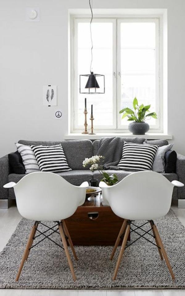 wohnzimmer skandinavisch einrichten couchtisch holz eames stühle