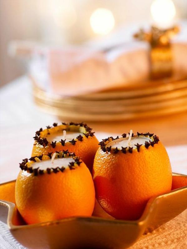 Weihnachtsschmuck basteln orangen in kerzenständer verwandeln
