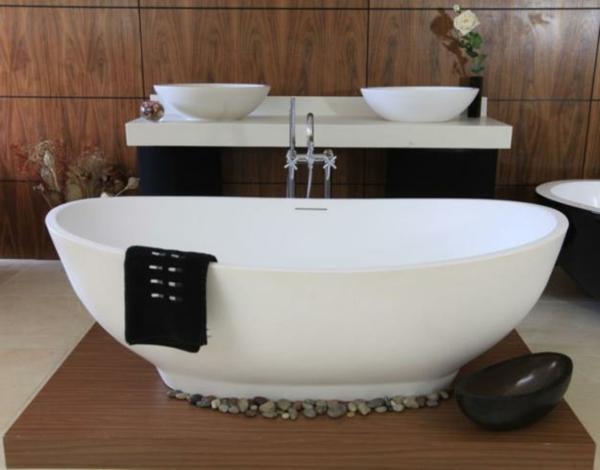 freistehende badewanne kieselsteine schüssel