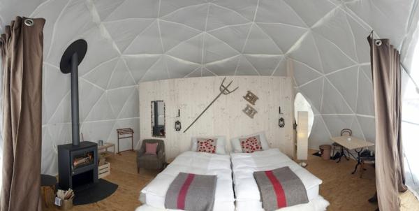 ökohotel iglu alpen doppelbett kamin