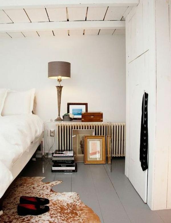 kuhfell teppich verlegen braun weiß als bettvorleger