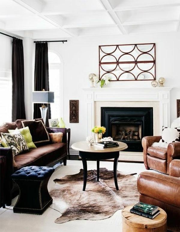 kuhfell teppich verlegen schwarz weiß wohnzimmermöbel ledersessel