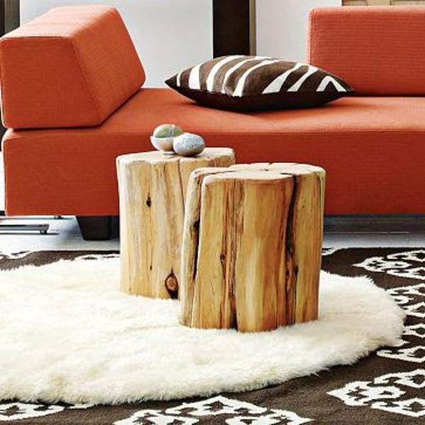 massivholz Couchtische orange sofa polsterung Baumstam hingucker