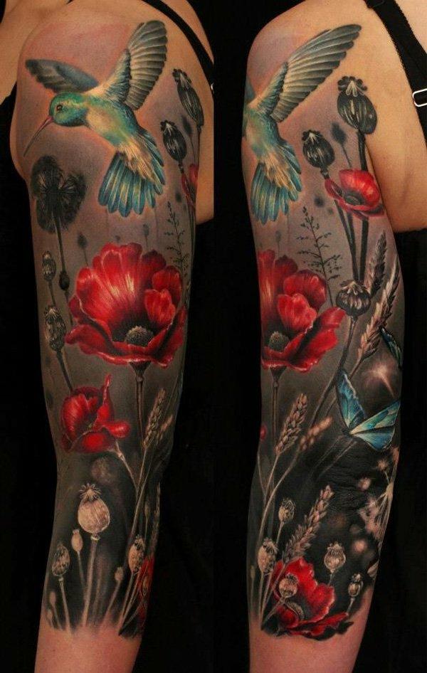 oberarm tattoo tribal blumen natur