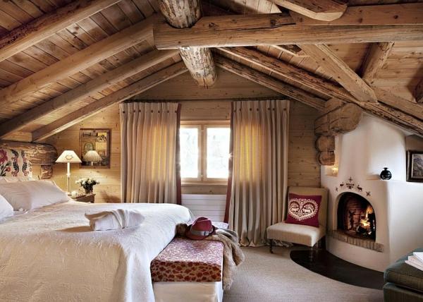 urlaub ferienwohnungen schweizer alpen kamin holzbalken