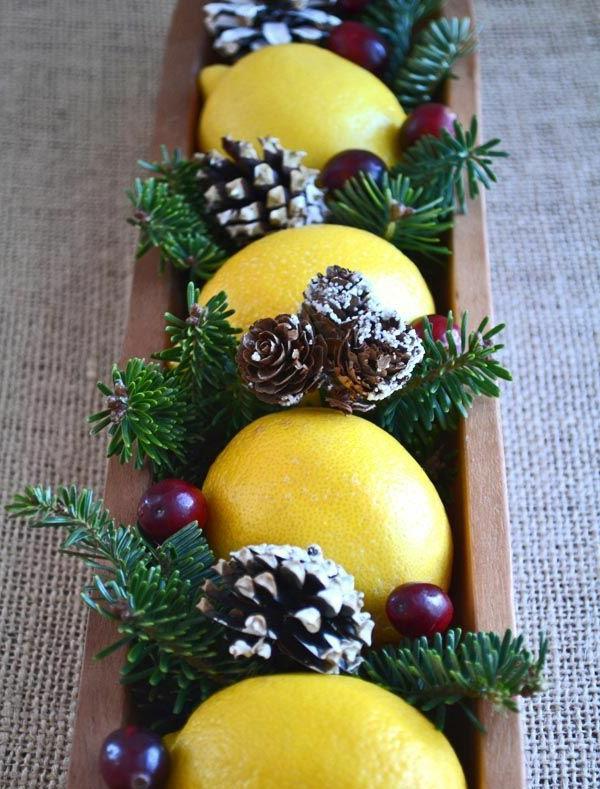 weihnachtsdeko tischdeko zitronen beeren zapfen