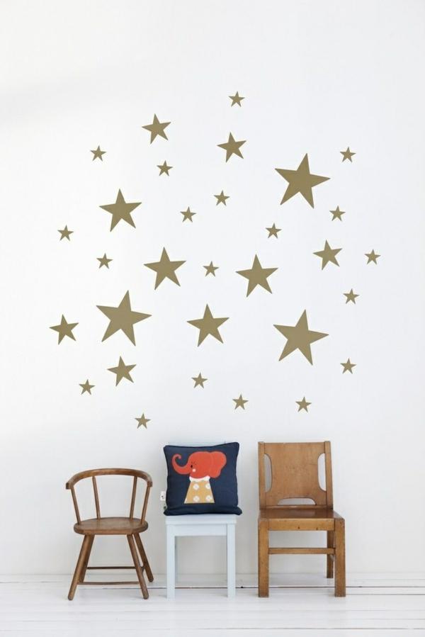 kinderzimmer wandgestaltung goldene sterne weiße wand