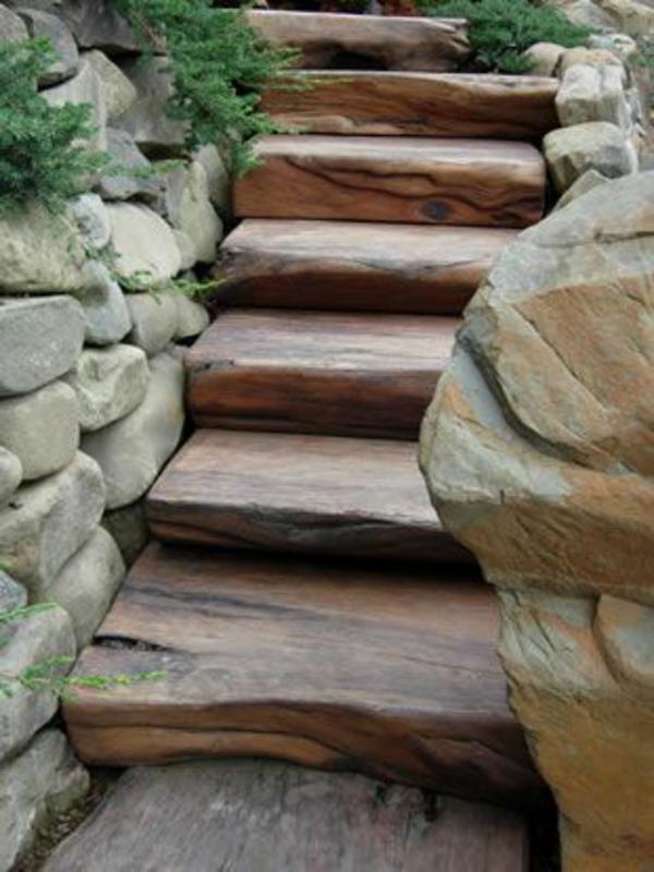 natursteinmauern im garten trittstufen holz treppe