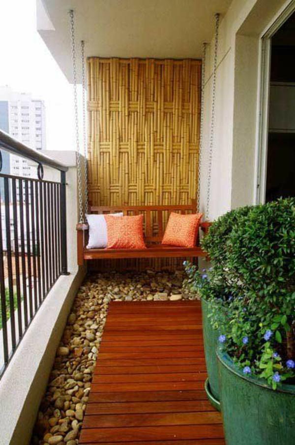 terrassenbelag holz dielen kieselsteine sichtschutz bambus