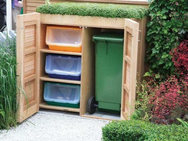 Mülltonnenbox im garten verstecken holzschrank gartenpflanzen hecke