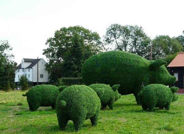 gartenskulpturen grüne schweine