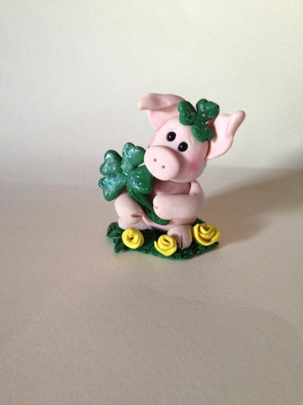 glücksbringerbedeutung schwein vierblättriger klee