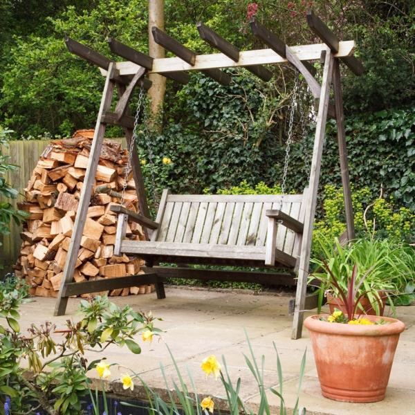 holzschaukel holz rustikal brennholz