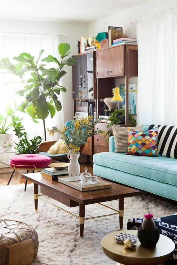 sofakissen farbige kissenbezüge hellgrünes sofa pflanze