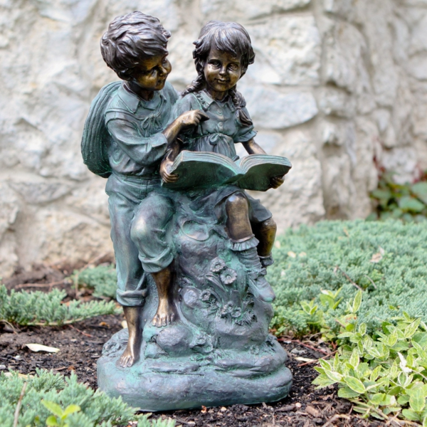 garten gestalten statue jungen lesend