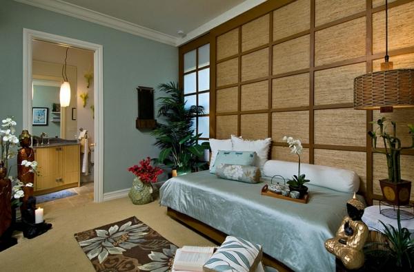 schlafzimmer einrichten asia seiden tagesdecke statuen