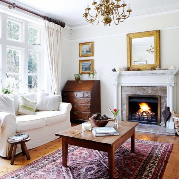 wohnung gemütlich einrichten farbiger teppich weißes sofa kamin