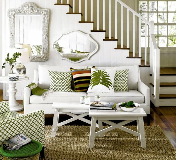 wohnzimmer einrichten grüne akzente weißes sofa