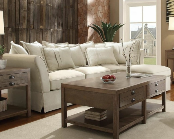 wohnzimmer einrichten weißer teppich dekokissen
