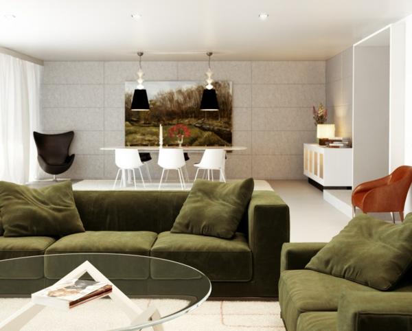 wohnzimmer einrichten runder gläserner tisch grünes sofa