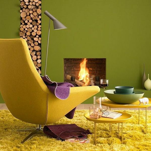 wohnzimmer sofa im raum:wohnzimmer gelbes sofa grüne wandgestaltung kamin