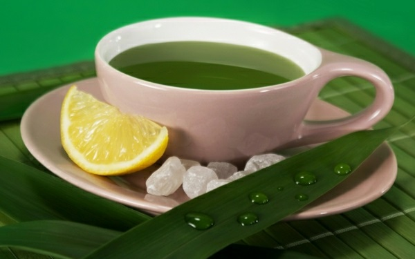 grüner tee wirkung tasse grün zitrone zucker