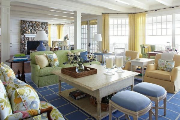 kissen landhausstil farbige muster blauer teppich