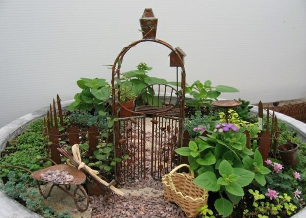 kleine gärten gestalten kieselsteine eingangstür schubkarre