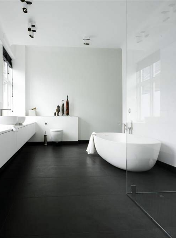 modernes badezimmer helle wände dunkler boden