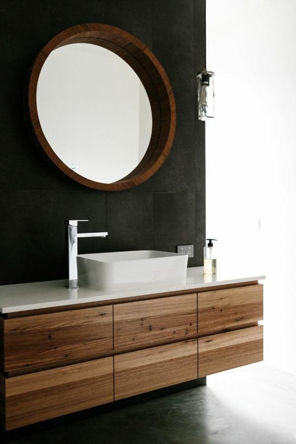 modernes badezimmer runder wandspiegel weißes waschbecken