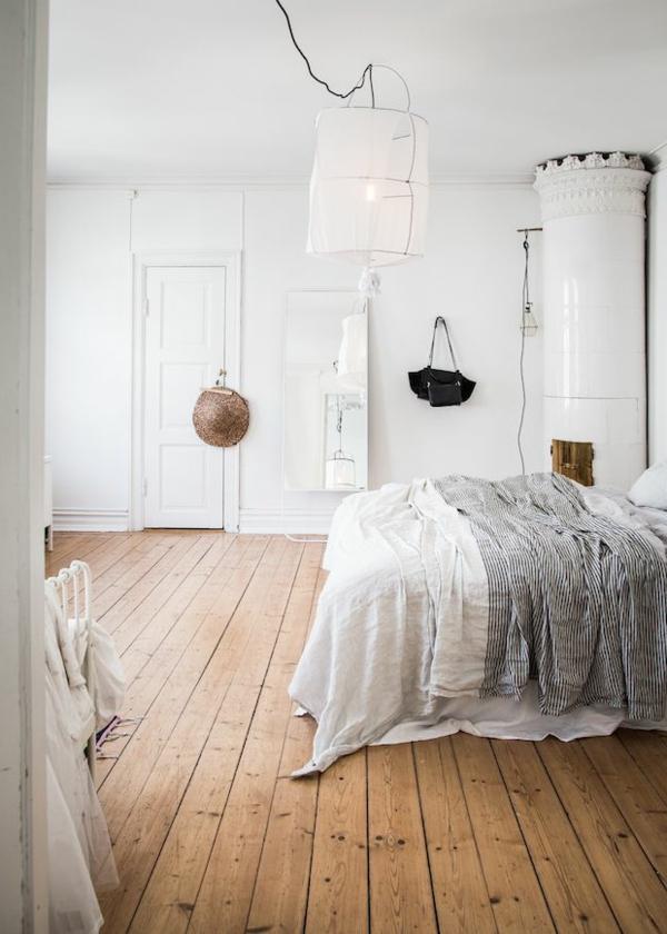 schlafzimmer design holzboden weiße wandfarbe rustikaler look