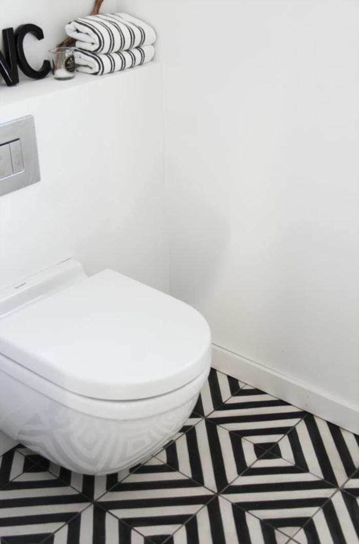 Gäste WC gestalten bodenfliesen schwarz weiß