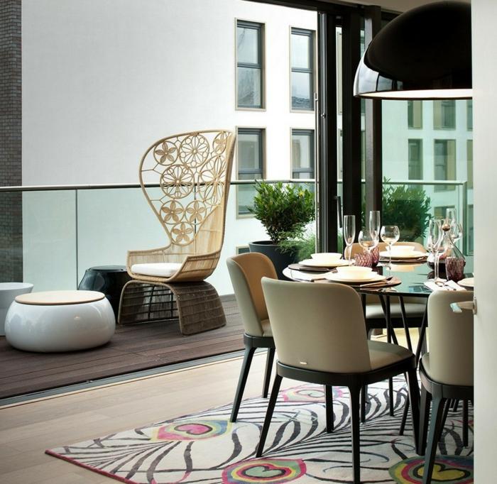 balkongestaltung elegante außenmöbel schöner teppich