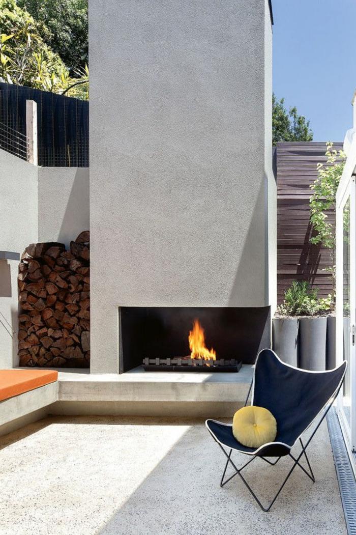 gartenkamin minimalistisches design sessel erholungsplatz außenbereich