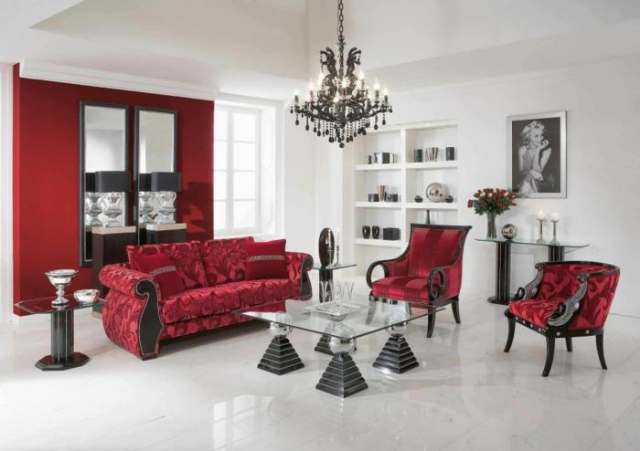 rote sofas luxuriöses wohnzimmer gläserner couchtisch